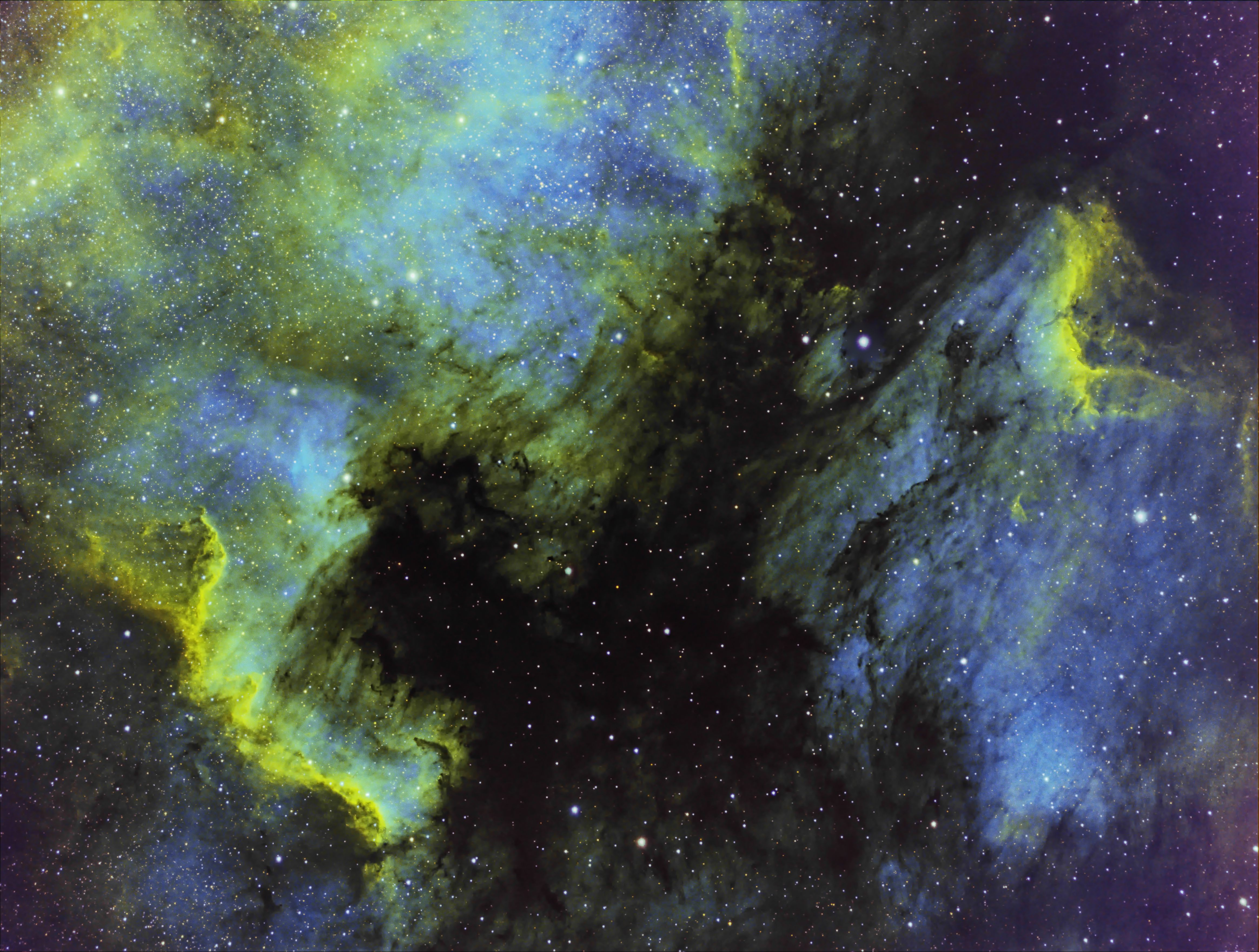 North American and Pelican Nebulas in narrowband HSO, Hubble Pallette.